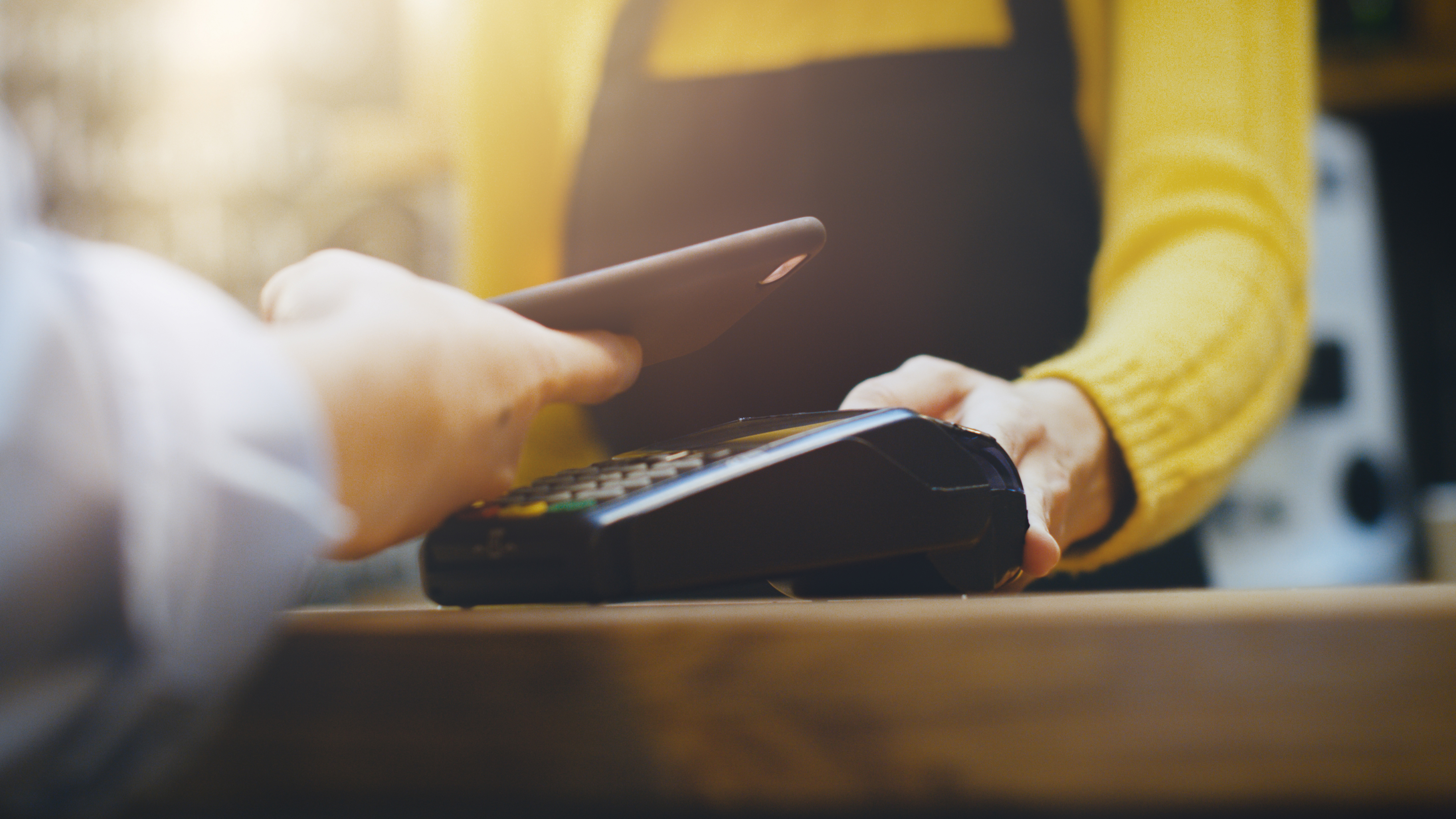 using smartphone to pay at retailer