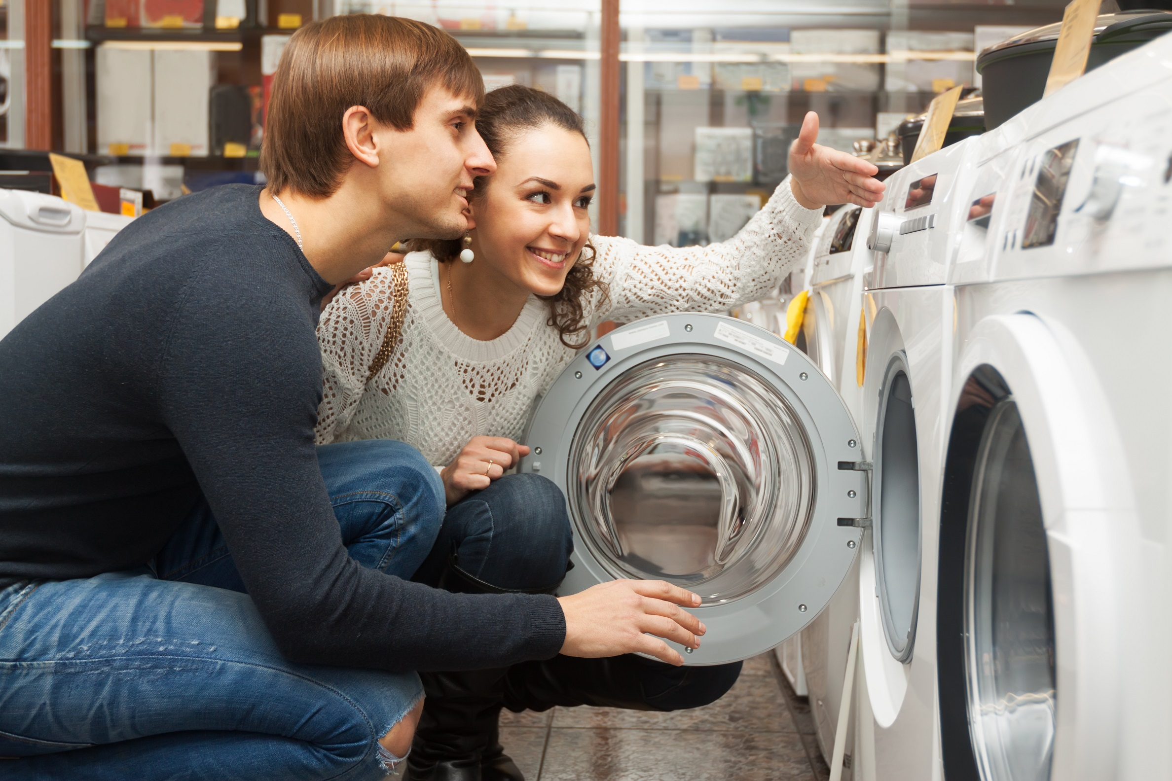 Couple shopping for energy efficient appliance.